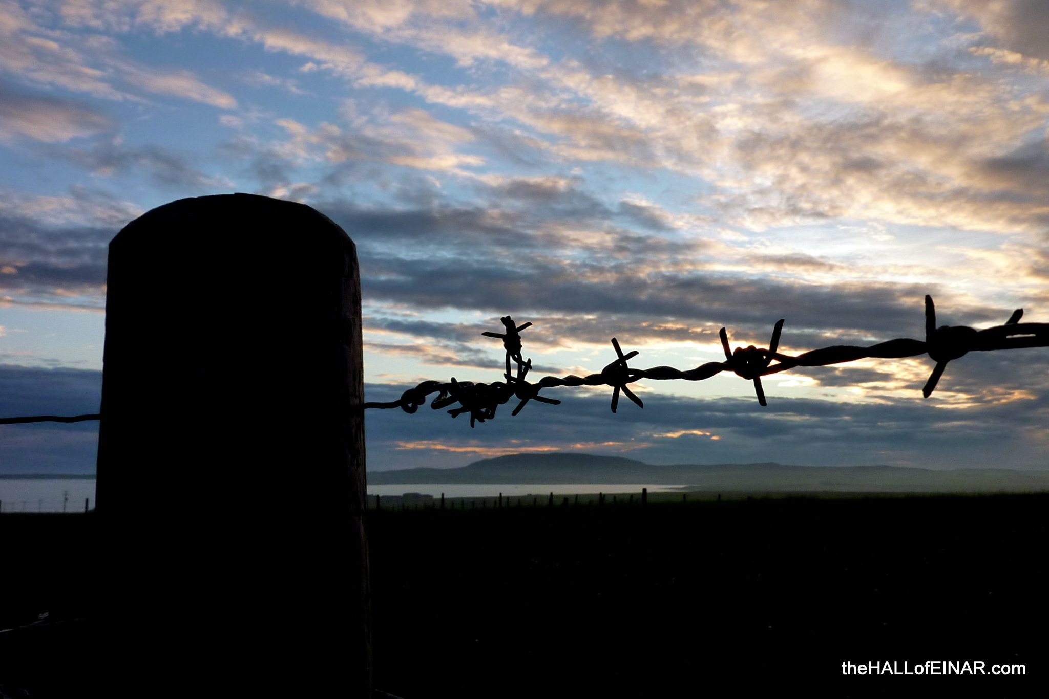 Barbed wire sunset - The Hall of Einar - photograph (c) David Bailey (not the)